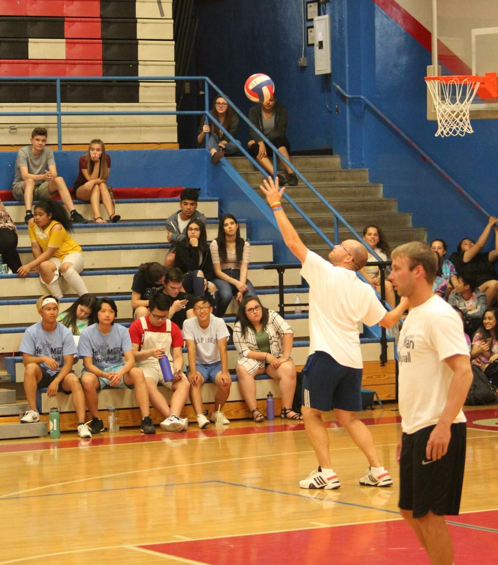 Teacher and Coach Ben Petersen makes a serve in last year's He-Man Volleyball game.